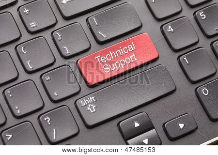 Red technical support key on black keyboard