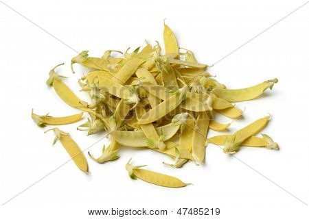 Heap of yellow snow peas on white background