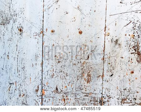 a white wooden wall as a background with copy space for a poster