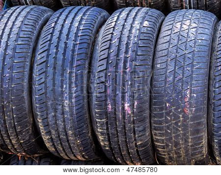 stack of worn car tires, symbolic photo for car tires, safety, accident risk