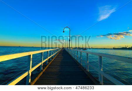 Sunlight reflection over pier