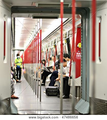 HONG KONG - OCTOBER 15: Riders on the MTR October 15, 2012 in Hong Kong, China. In 2012 the MTR reportedly had 46.4% of the public transport market, making it the most popular transport in Hong Kong.
