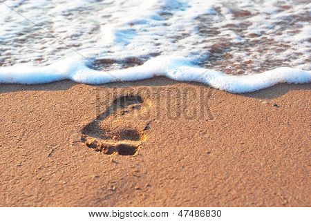 Footstep On The Sand And Sea Spume