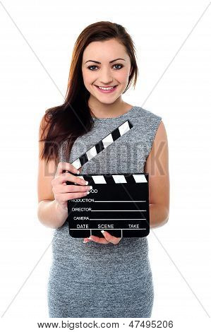 Attractive Woman With Clapperboard