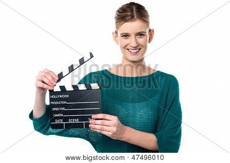 Young Girl Posing With Clapperboard