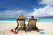 image of couple sitting beach  - Couple on a tropical beach at Maldives - JPG