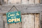 stock photo of announcement  - Vintage open sign on old wooden door - JPG