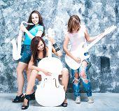 stock photo of sax  - female rock band - JPG