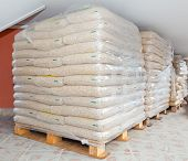 picture of wooden pallet  - Pallets of wood pellets in plastic bags - JPG