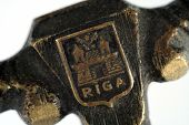 pic of armorial-bearings  - bronze engraving on the antique old thing with Riga emblem - JPG
