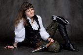 stock photo of crossed pistols  - Girl on black with pistol and pirate hat - JPG