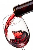 pic of red wine  - Red wine poured in a glass isolated on a white background - JPG