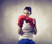 stock photo of pugilistic  - brave woman does boxing - JPG