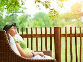 stock photo of sleep  - Cute girl resting on veranda - JPG