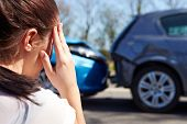 stock photo of wrecking  - Stressed Driver Sitting At Roadside After Traffic Accident - JPG