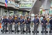 BANGKOK,THAILAND- JUNE 30 : Unidentified polices stand guard on pathumwan road during a Guy Fawkes a