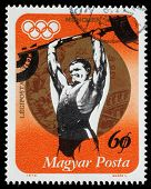 HUNGARY - CIRCA 1973: A stamp printed in Hungary, shows Weightlifting and Gold medal, with inscripti