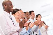 stock photo of applause  - Successful business group applauding after a presentation - JPG