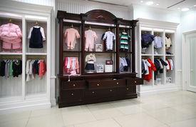 stock photo of department store  - Interior of modern Babyish clothing department empty hall - JPG