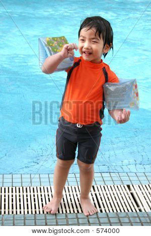Boy Standing By The Pool