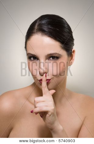 Woman signaling to be quiet