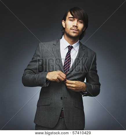 Attractive Businessman Getting Dressed On Black Background