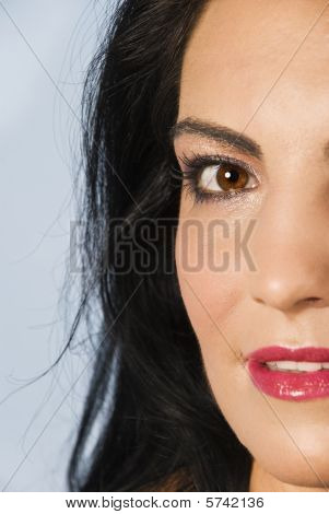 Half  Face Of Smiling  Brunette Woman