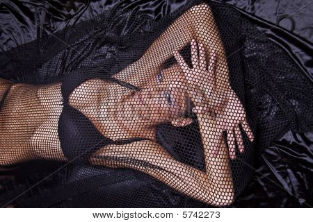 Woman Trapped In Black Fishnet