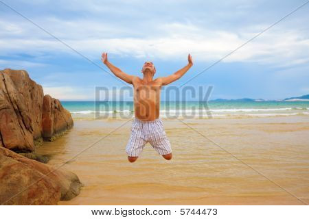 Man Jumping On The Beach