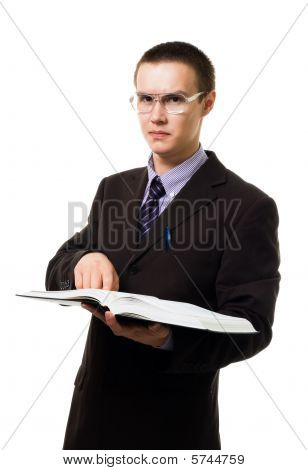 Clever Man With Huge Book In Glasses