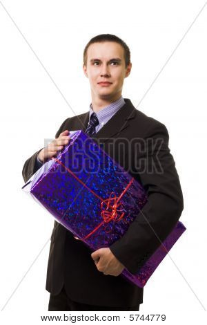 Young Handsome Man With One Huge Blue Gift