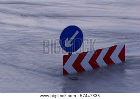 Direction Boards On The Flooding River