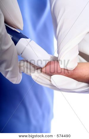 Nurse And A Diabetic Finger Stick