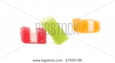 Three different fruit-paste candies.