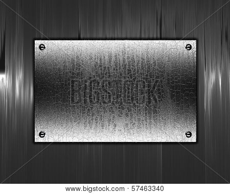 Beautiful metal background with a metal nameplate for writing.