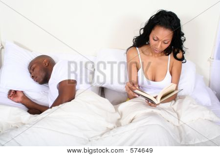 African Amrican Couple In Bed