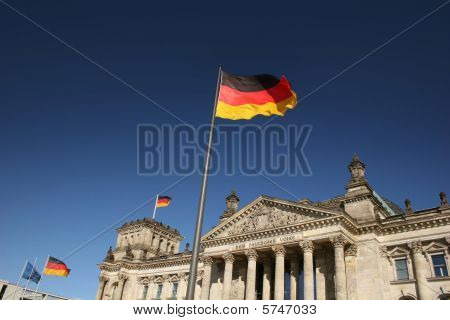 German Parliament Reichstag in Berlin with flaggs
