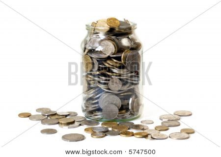 Overflowing Jar Of Coins