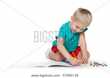 Cute Little Boy Drawing On Paper