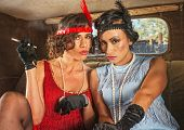 picture of gangster necklace  - Pair of retro women smoking inside antique car - JPG