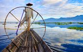 stock photo of fishermen  - Fishermen in Inle Lake at sunrise Inle Shan State Myanmar - JPG