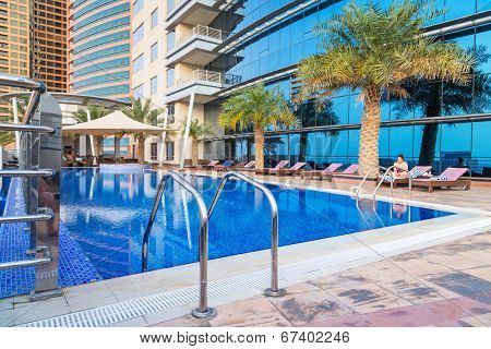 ABU DHABI, UAE - 31 MARCH 2014: Pool area of The Grand Midwest Tower Hotel in Dubai, UAE. The Grand Midwest Group owns 4 hotels in Dubai with over 700 rooms.