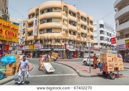 DUBAI, UAE - MARCH 31: People on the street of Deira area in Dubai on 31 March 2014, UAE. Deira is an old commercial center of Dubai with many traditional arabic shops and biggest street market.