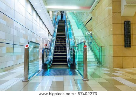 DUBAI, UAE - 31 MARCH 2014: Escalator in Dubai metro, UAE. The Dubai Metro is a driverless, fully automated metro rail network in the city of Dubai and carry over 180,000 passengers every day.