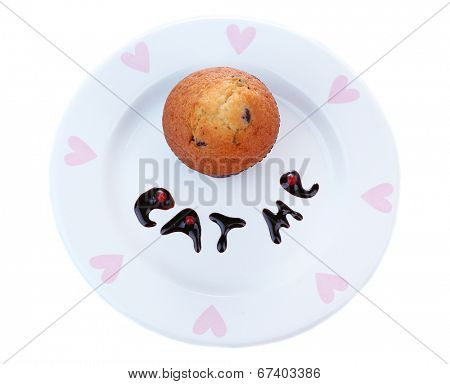 Tasty muffin on plate isolated on white