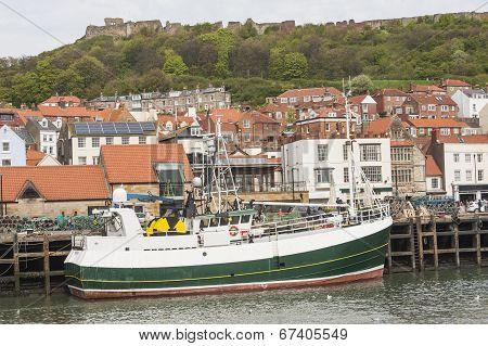 Fishing Trawler In Small Town Harbor
