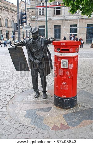 Newspapers Seller Sculpture In Porto, Portugal