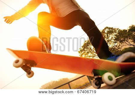 skateboarding woman on sunrise skatepark
