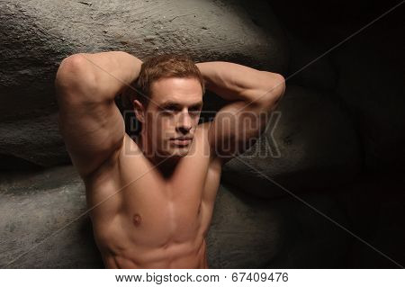 Strong man holding stone