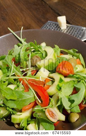 Arugula Salad With Tomatoes, Olives And Parmesan